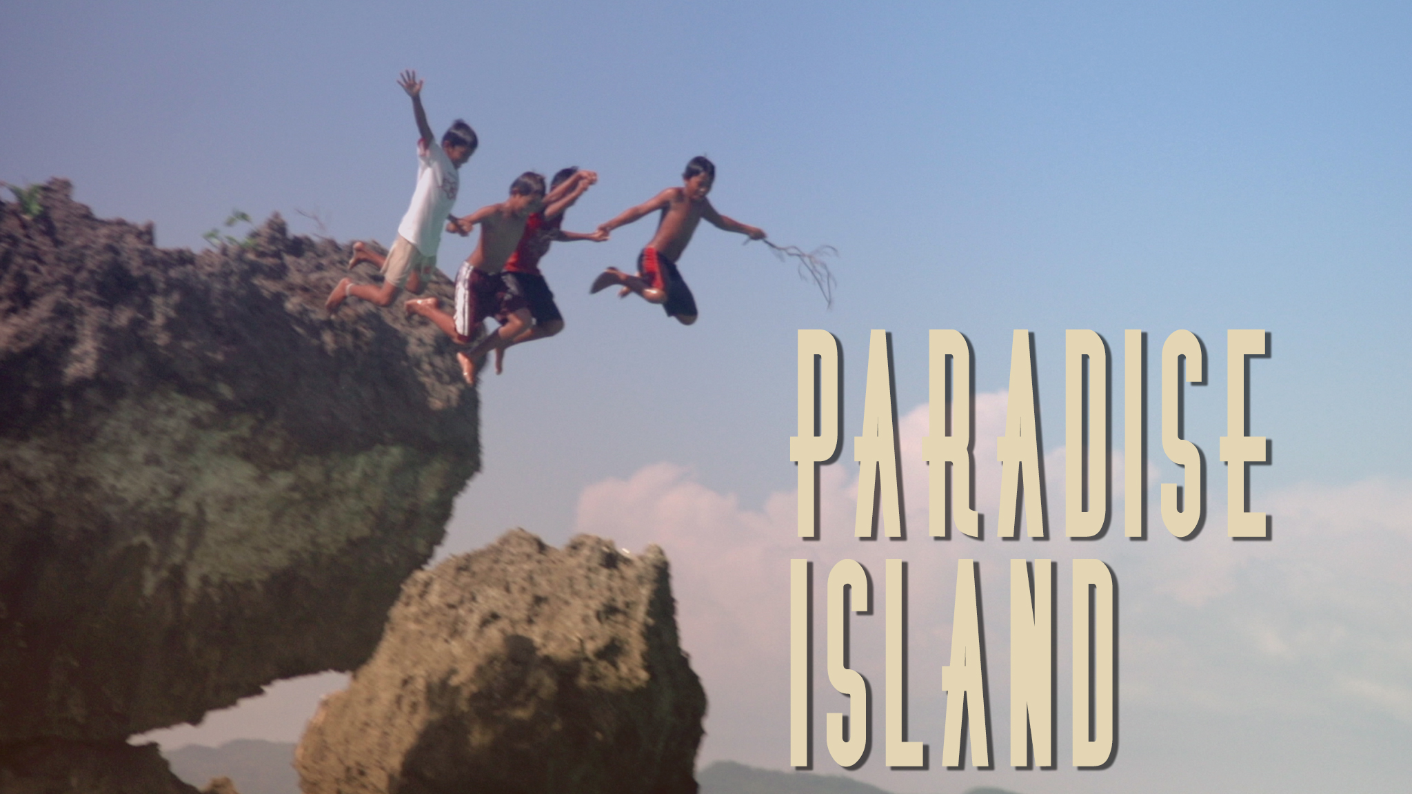 Photo of kids jumping off cliff into water acts as a link to the Paradise Island film page