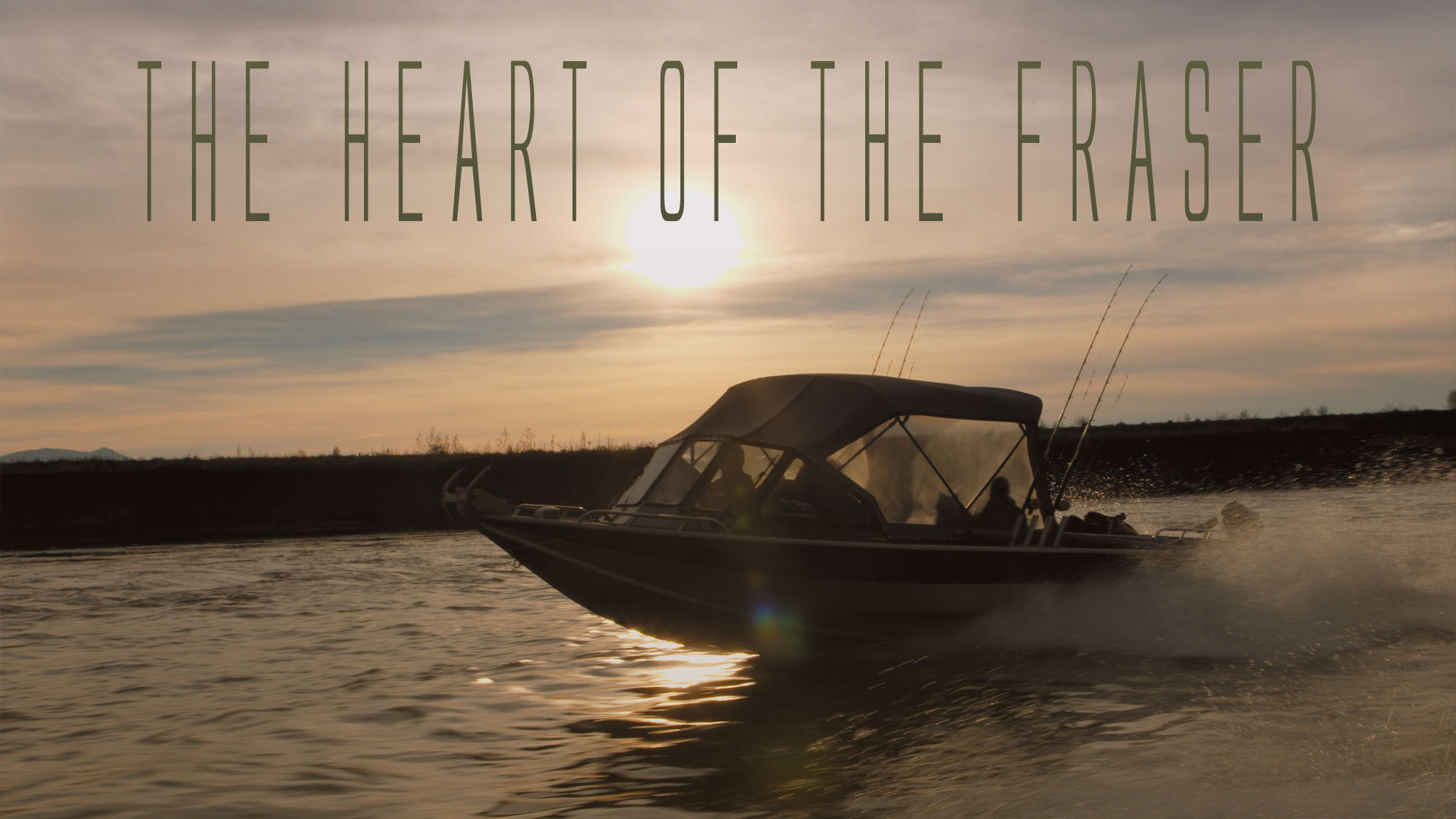 photo of a boat travelling across the Fraser River at sunset
